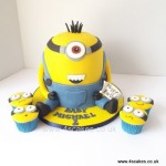 3D hand carved Minion cake and cup cakes