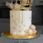 White and gold wedding cake by London cake shop